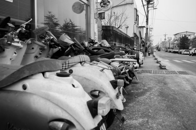 Scooters lined up outside a store, Uam-dong, Cheongju, December 2014